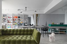 Ganna Design renovated an apartment in Taipei City, Taiwan, for a couple and their puppy with the triangle being a design element.
