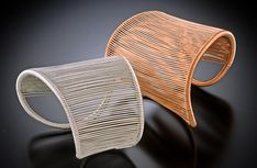 """Copper and sterling silver asymetrical bracelets"" by Tana Acton"