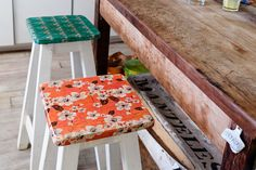 Jana bought these stools and covered each seat with a decoupage in different patterns and colors.