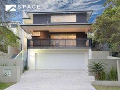 Concrete modern house exterior with balcony & landscaped garden - House Facade photo 525885