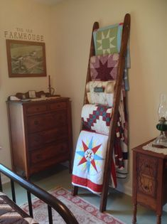 Old ladder turned into a quilt rack.