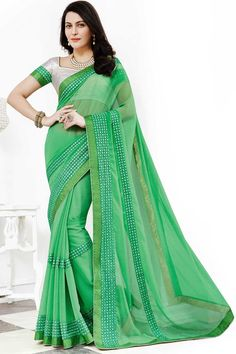 Green chiffon saree with white silk blouse.  Embellished with embroidered, zari and stone.  Saree comes with v neck blouse.  http://www.andaazfashion.com/womens/sarees/view/new-arrival-saree