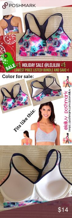 """Yoga push-up sports bra watercolor mesh back NWT. 💐Hold that pose! This juniors' SO sports bra gives you an extra boost during yoga class. Cute and comfy with a little extra oomph. 💐Features a banded bottom (13.5"""" W laying flat), racerback straps and a padded cup for uplifting support. Approx. 12"""" L from top of strap to band)💐❗️Smoke-free❗️No trades.  💐PRODUCT FEATURES: ✔️Low-impact support ✔️Push-up design ✔️Colorblock styling ✔️Breathable mesh racerback ✔️Wire free 💐FABRIC & CARE…"""