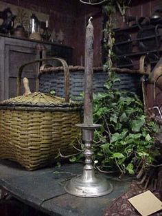 Luv the look of these mustard and blue baskets with the pewter candlestick! Simple but awesome.
