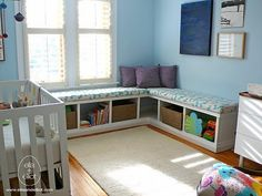 Ikea bookshelves laid flat. Lowes foam covered with fabric. PLAY ROOM bookshelf and toy bins