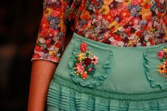 Madly in love with the skirt and pockets.