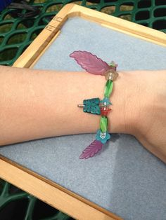 Flower and butterfly stretch bracelet. Bright summer colors remind us of nature and to support our planet. One size fits all.  Get the matching earrings! https://www.etsy.com/listing/533911468/flower-safety-pin-dangle-earrings?ref=shop_home_active_1  Proceeds benefit EarthJustice:  www.earthjustice.org  Today's environmental challenges are greater than ever. But we live in a country of strong environmental laws—and Earthjustice holds those who break our nation's ...