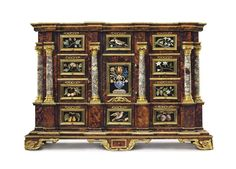 A SOUTH GERMAN GILT-BRONZE AND PIETRA DURA-MOUNTED TORTOISESHELL, MARQUETRY AND PARCEL-GILT CABINET. AUGSBURG, CIRCA 1650-1680, THE PIETRA DURA PLAQUES ATTRIBUTED TO THE GRAND DUCAL WORKSHOPS. Of architectural form, the central cupboard door mounted with a large plaque depicting a flower-filled baluster vase, opening to reveal a sliding compartment concealing eighteen secret drawers. 29 in. (73.5 cm.) high, 42 ¼ in. (107.5 cm.) wide, 18 ¾ in. (47.5 cm.) deep. -Christie's- Ivory Cabinets, 3rd Millennium, Art Cabinet, Natural Curiosities, Classic Architecture, Botanical Drawings, Stargazing, Tortoise Shell, Flower Vases