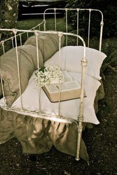 I DID THIS WITH AN ANTIQUE BABY BED ALSO:) USED A LRG PATIO CUSHION/COVERED FOR SEAT.