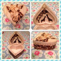 Giraffe pyrography on a heart shaped trinket box