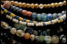Beads from the Viking age. Grave find, Björkö, Sweden. Glass, gold foil, silver, rock crystal and carnelian.
