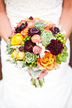 Bridal Bouquet - Succulents with Orange Garden Roses and Pops of Purple/Pink | via: http://www.andreafreemanevents.com/space-abbott-kinney-los-angeles