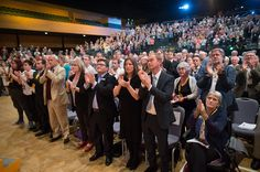 Liberal Democrats join Sarah Gurling as they applaud at the end of a special tribute to exleader Charles Kennedy on the fourth day of the Liberal.