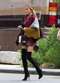 Olivia Palermo in overknee heels, shirt skirt and a carpet around her shoulder