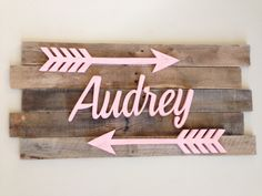 **NEW ITEM!*** This unique custom made reclaimed wood sign would make a great personalized touch to any nursery or childs room. Made from solid reclaimed wood slats that are hand selected. No two wood pieces are the same giving your child a truly unique one of a kind item that they can keep a lifetime. Name & arrows are distressed to give the sign a worn/rustic look. This sign measures 17 X 35. Sign includes your childs name and two 20 arrows in paint color or your choice. I can pa...