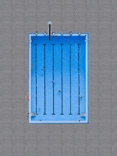 Minimalist aerial photography of swimming pools