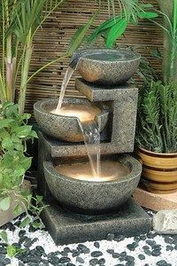Contemporary fountain, doing this with some copper and glass bowls would look great too