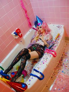 Obviously not shooting in a bathtub but I like the overall look of the party hat, plastic leis, confetti, etc.