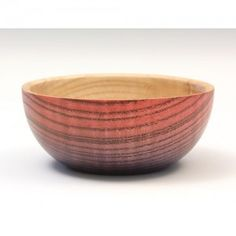 Ash coloured bowl, red, blue and black