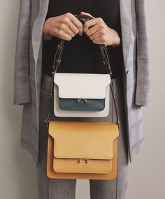Two bags are better than one, especially when its Marni. Shop Marni at Farfetch.
