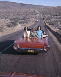 #travelcolorfully back view of girls in US classic carbriolet car on US highway - 1960's
