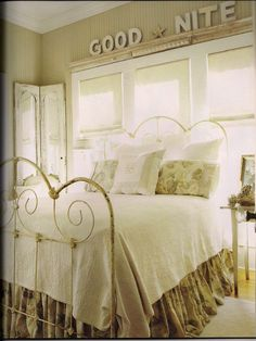 Love the soft muted colors, the bedtime message above is a nice touch. There is something so crisp and fresh about a white matelasse coverlet or spread. Look at the bed skirt puddled on the floor.