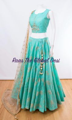 CHOLI-Raas The Global The Global Desi Color : sky blueFabric : silk,netOccasion : WeddingOccasion : PartyWork : zari skirt length is 41 inches approx For any query CALL : 630 407 7419 Choli Designs, Lehenga Designs, Indian Lehenga, Lehenga Choli, Floral Lehenga, Bridal Lehenga, Sharara, Pakistani Bridal, Indian Bridal