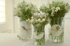 ALL WHITE- Babies Breath, White Tulips, and Calla Lilies Arrangements + with Attached Doilies + Twine Ribbon + Attached Sprig of: Rosemary, a Pine Leaf, Babies Breath or other Small White Flower. (So pretty, white, and organic looking.)