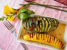 Light and easy hasselback zucchini baked with garlic, basil and sun-dried tomatoes and dash of white wine. Delicious side dish!.