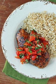 This Bruschetta Topped Balsamic Chicken may look fancy but it's super simple! Just 293 calories or 7 Weight Watchers SmartPoints per serving.