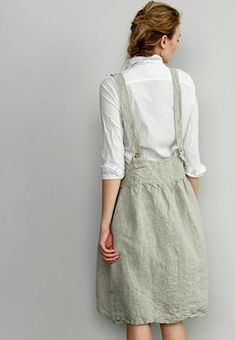 MARRAKECH SKIRT 100% LINEN SHOWN IN NATURAL AVAILABLE AS WELL IN CHARCOAL, WHITE AND SMOKE. SIDE POCKETS, ADJUSTABLE STRAPS MACHINE WASH WARM MACHINE DRY LOW ALL ITEMS ARE CUSTOM MADE. PLEASE ALLOW 2-6 WEEKS FOR DELIVERY