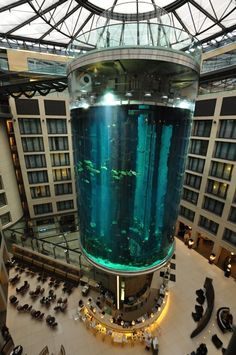 AquaDom is a huge size of aquarium in Berlin, Germany. It's about 25 meter tall cylindrical acrylic glass aquarium and has a built-in transparent elevator. It is located at the Radisson Blu Hotel in Berlin-Mitte. Hotel Lobby, Hotel S, Barcelona Hotel, Berlin Hauptstadt, Hotel Berlin, Berlin Berlin, Germany Berlin, Ouvrages D'art, Radisson Hotel