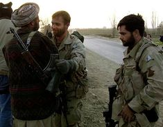 U.S. special operation troops greet the local northern alliance commander while his soldiers fight pro-Taliban forces at a fortress near Mazar-e-Sharif, Afghanistan, Monday, Nov. 26, 2001.