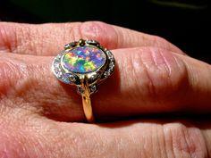 Stunning Black Opal Diamond ring. 14K Solid Gold.White Diamonds.Lightning Ridge Australian Black Opal.Harlequin style vintage ring. Pristine by AmyKJewels on Etsy https://www.etsy.com/listing/248762292/stunning-black-opal-diamond-ring-14k