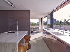 Modern single family residence located in Long Island, New York, designed by Stelle Lomont Rouhani. Kitchen Interior, Kitchen Design, Long Island House, Kitchen Pass, Limestone Wall, New York, Second Floor, Windows And Doors, Midcentury Modern