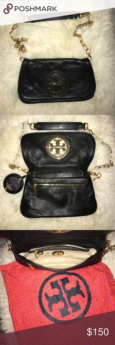 Tory Burch Logo Clutch Black leather Tory Burch crossbody clutch with removable gold chain. Make up mirror and dust bag included. Leather is impeccable and it shows minor scratches in the inside logo. Tory Burch Bags Clutches & Wristlets