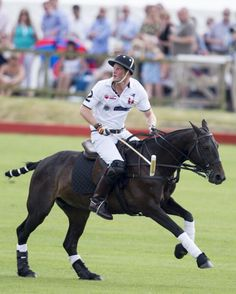 Prince Harry plays in a charity polo match at Beaufort Polo Club on 22.06.14 News Photo 451047108