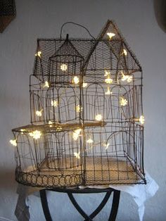 put white lights in large, vintage birdcage...cool decor for year round