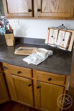 Faux Concrete Countertop Makeover-THIS IS BEAUTIFUL - These are my kitchen cabinets - love this counterop.