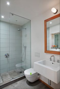 """There's no door to the left of the fixed glass. We actually adhered an extra layer of 1/4"""" sheetrock to the wall so the finish planes of tile and wall align (grout line between the two). The vertical glass panel is recessed into an aluminum channel set into the wall and the joint between channel and tile is clear silicone.  Shower is 160 cm long."""