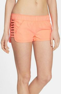 Hitting the beach in these coral cut-out board shorts | O'Neill