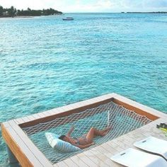 I've always loved hammocks but this takes the cake... imagine windy days where you could get wet from the waves.. <3