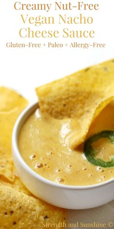 No dairy needed in this Creamy Nut-Free Vegan Nacho Cheese Sauce! Low-fat, gluten-free, paleo, and allergy-free; everyone can enjoy some healthy dipping! A tummy-friendly recipe, made quick & easy in a blender. You'll be using this queso sauce for more than just chips!
