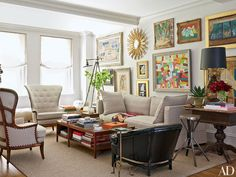 Ornately-framed paintings cover a wall of this Manhattan living room.