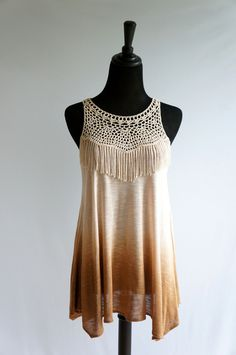 """beautiful top that has never been worn and still has the tags attached!  Features a crochet and fringe front with a key hole back and fades from lighter brown to dark brown.  Size Medium fits true to size or 4/6.  Measurements:  Length: 29""""  Bust (laid flat across): 16"""""""