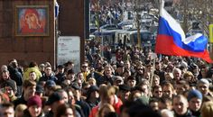 Protesters march through Moscow's Tverskaya St. during an unauthorized anti-corruption rally on March 26.