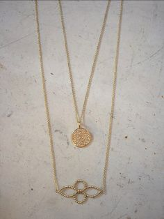 Layering two of our staple necklaces. The pave diamond disc necklace & the 4 petal flower necklace both in yellow gold.