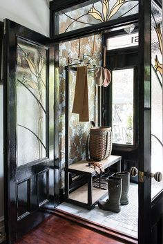 In the entry vestibule of this character-filled home, an industrial hall tree topped with bamboo hat holders adds a functional element to a diminutive space. Future House, My House, Decoration Hall, Design Entrée, Design Ideas, Small Room Design, Entry Foyer, Door Entry, Porch Entry