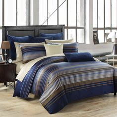 This handsome deep navy cover set is accented with golden brown, cream, and soft grey textured stripes. It works equally well in a unisex or...
