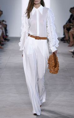Rendered in cotton, this **Michael Kors Collection** top features ruffle detailing on the sleeves and a collared design.